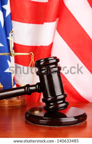 Judge gavel on american flag background - stock photo