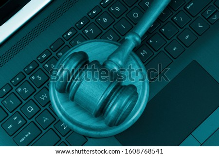 Judge gavel on laptop computer keyboard, top view. Cyber law and crimes concept.