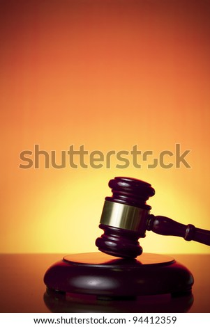 judge gavel on orange background
