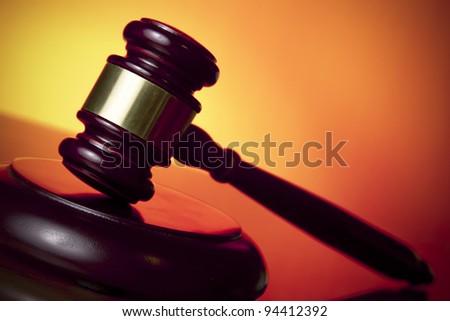 judge gavel on orange background