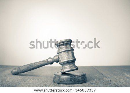 Judge gavel on table. Symbol of justice. Retro style sepia photo