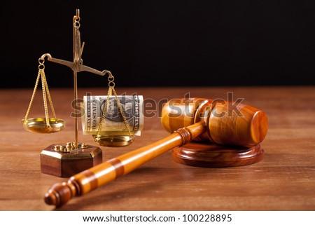 judge gavel scales with money