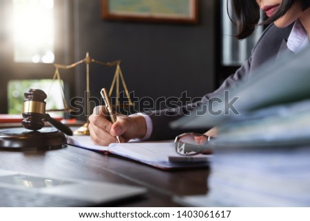 Judge gavel with Justice lawyers, Business woam in suit or lawyer working on a documents. Legal law, advice and justice concept. #1403061617