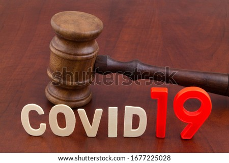 Judge gavel with letters covid19. Concept laws against covid-19. ストックフォト ©
