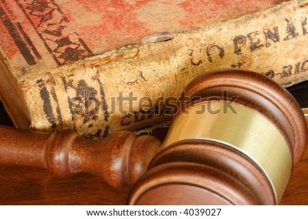Judge hammer and old legal code