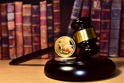 Judge hammer and XRP crypto coin. Justice courtroom. Ripple demands Bitcoin and Ethereum docs from SEC amid legal fight. Delist сryptocurrency trading. Exchanges and traders. law to ban blockchain