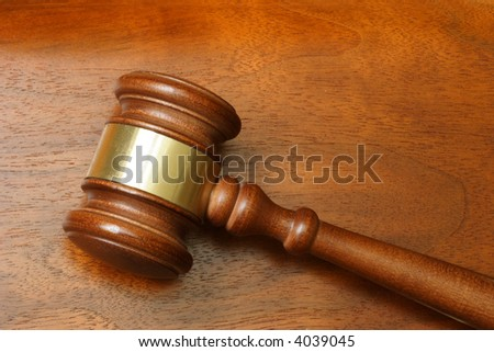 Judge hammer over a wooden background - stock photo