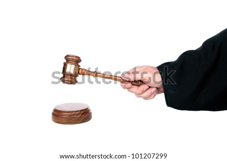 Judge hits a sound block with his gavel.  Image is isolated for designer convenience.