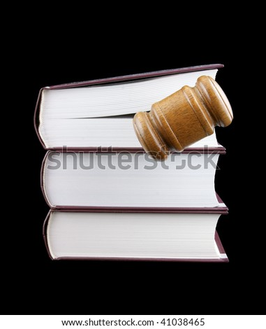 Judge's gavel and stack of legal books isolated on black