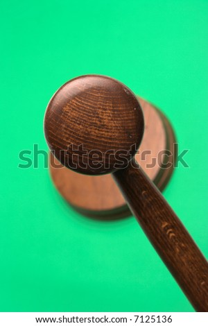 judge's gavel,close up over green background