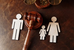 Judge's gavel divide family figures. Family law and divorce concept