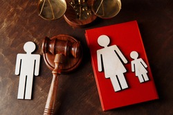Judge's gavel divide family wooden figures. Family law and divorce concept