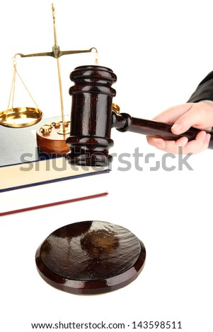 Judge's gavel in hand isolated on white