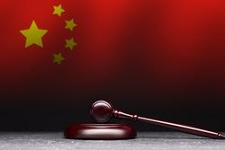 Judge's gavel on background of flag of China.