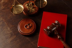 Judge's gavel on book and rings