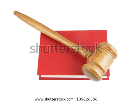 Judge's gavel on red legal book isolated