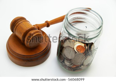 judge's legal gavel and coin jar with money - stock photo