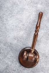 Judge's wooden gavel on grey background, vertical. Law concept