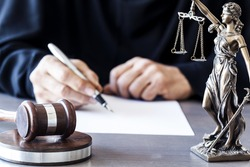Judge with wooden gavel on table