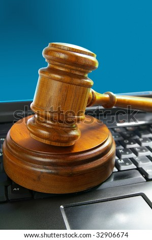 judges court gavel on a laptop pc keyboard