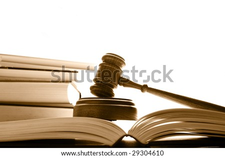 judges court gavel on law books, over white - stock photo
