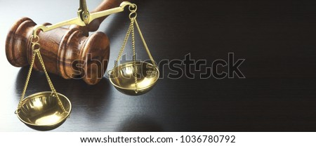 Judges Gavel And Scale Of Justice On The Black Table Background  In Back Light. Overhead View. Law Concept. Abstract Web Banner.