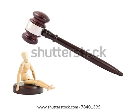 Judges gavel and wooden mannequin. Guilty concept.
