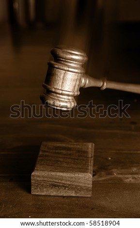 judges gavel  coming down and hitting the block gavel blurred for movement