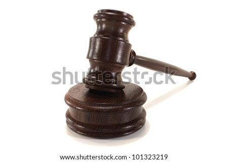 judges gavel of wood on a light background - stock photo
