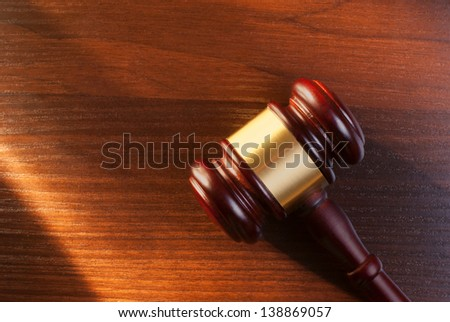 judges gavel on a brown table