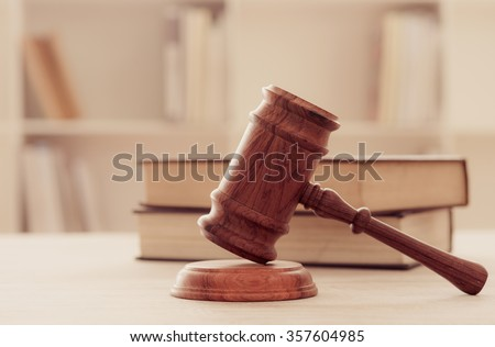 Judges gavel on wooden table with law books. retro style. concept of legal ruling. - Shutterstock ID 357604985