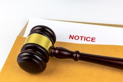 Judges gavel or hammer on document of prosecution about Notice in brown envelope.Concept of  litigation and verdict of attorney.