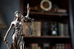 Judges gavel, statue of justice, scales, book background. Law concept.