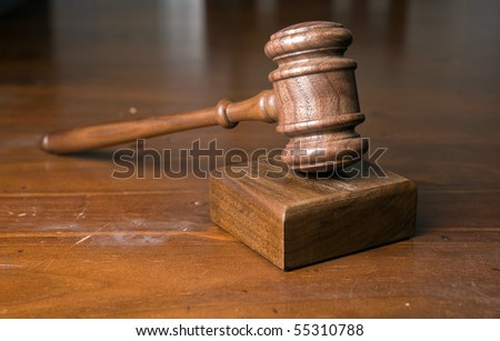 judges or auctioneers gavel on wooden table