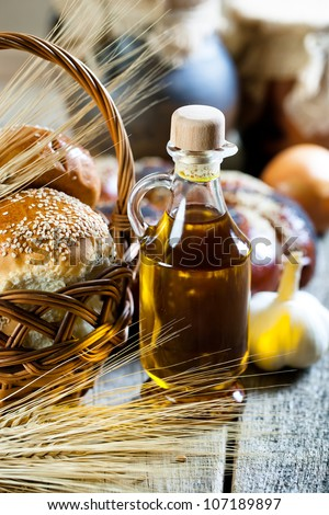 Jug and bottle of sunflower oil with flower
