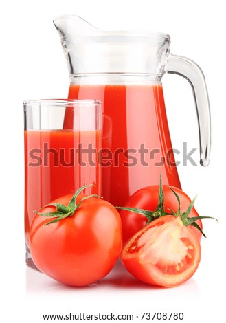 Jug, glass of tomato juice and fruits with green leaves isolated on white