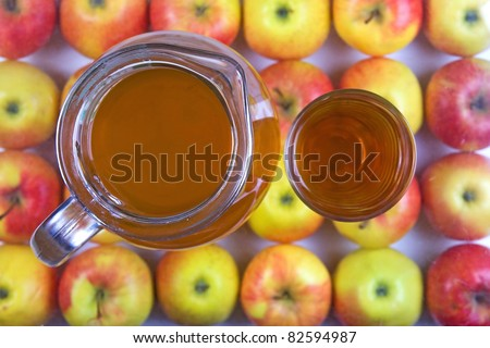 jug of apple juice with apples - stock photo
