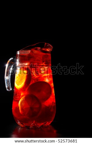 Jug of chilled Spanish sangria with fresh fruit