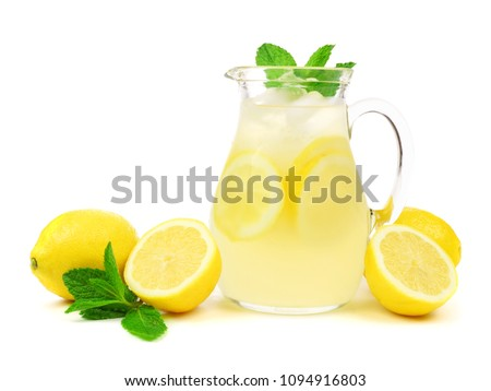 Jug of summer lemonade with lemons and mint isolated on a white background