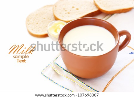 jug with milk and bread isolated on white background