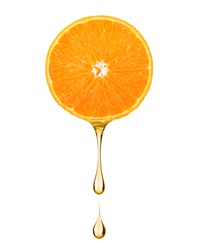Juice in the shape of drop flowing from a slice of orange, on white background