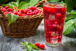 Juice of fresh raspberries served with ice in a glass