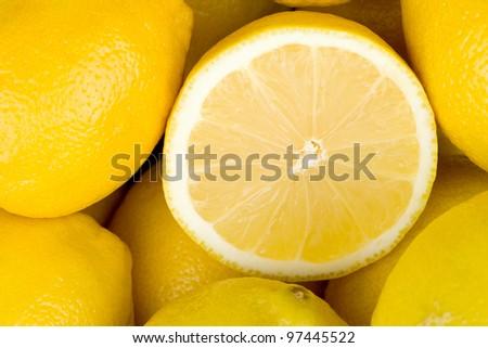 Juice ripe lemons closeup background