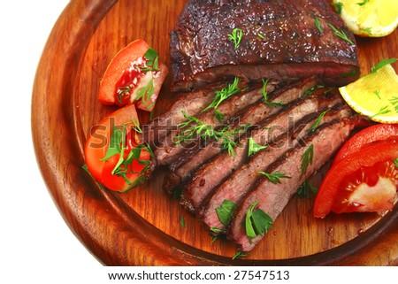 juice roast meat on wood shelf with tomato