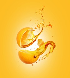 Juice splashes out from sliced orange on a yellow background