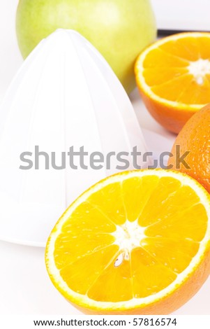 Juicer, oranges and green apple, closed-up