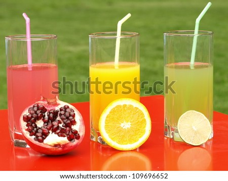 Juices from pomegranate, orange and lime