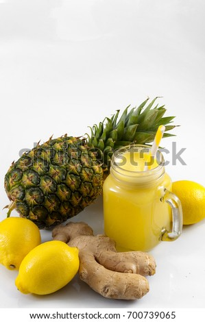 Shutterstock Juicing raw fruits and vegetables and juice extractor recipes concept with pineapple, lemon and ginger, the ingredients for a detox smoothie that helps with inflammation and digestion