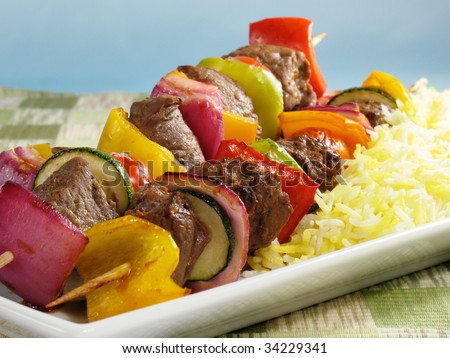 Juicy beef kabobs with bell peppers, onions, zucchini, and cherry tomatoes. Served with saffron flavored basmati rice.
