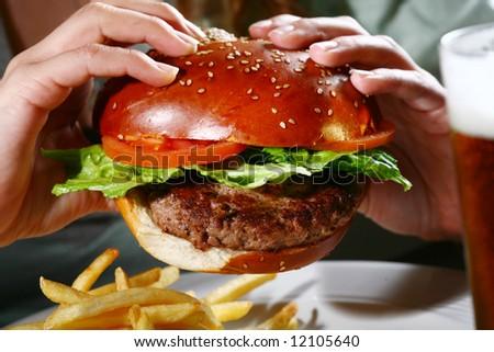 Juicy burger in hands
